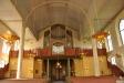 till höger 1878 års kyrka påbörjad.