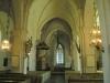 En av två medeltida ljuskronor i koret