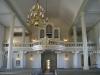 Över dopaltaret en mosaik som Akke Hugh Malmeström förärat kyrkan