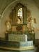 Den praktfulla altaruppsatsen från 1716 av Erich Bergman  omger korets glasmålning