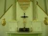 Målningen till vänster om altaret