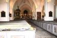 Dopfunten i dopkapellet är tillverkad vid 1200-talets mitt. Utanför hänger två begravningsvapen.