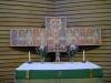 På väggen bakom predikstolen/ambon hänger denna tavla