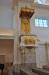 På predikstolen evangelisternas symboler i guldfärg