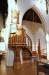 Ovanför predikstolen i gotisk  stil hänger ett Kristusporträtt utfört av Elisabeth Keyser