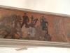 votivskeppet och predikstolen. Bakom altartavlan en målning påväggen.