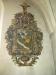 I vapenhuset vilar den medeltida dopfuntens cuppa på träställning