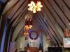 Julaftons bönestund med mycket musik och fullt i bänkarna. Många barnfamiljer.