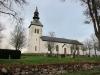 Edsvära kyrka på höga höjder med översikt på västgötaslätter.