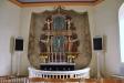 Ängel som håller timglaset på predikstolen