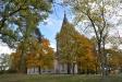 Förslgsvis kunde man kanske ta bort de två träd som står närmast kyrkan!