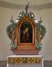 Altartavlan som inköptes 1884 försågs med sidostycken och överdel 1950-51