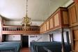 Söder om kyrkan finns en fristående klockstapel uppförd 1697