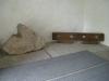 I vapenhuset: urholkat stenklot som legat som stöd under predikstolen