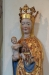 Det stora triumfkrucifixet hänger till vänster om altaret.
