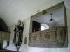 Bilderna på predikstolen härrör från det gamla altarskåpet. De höggs av för att passa in. (1677)