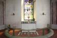 Altaret uppbyggdes 1972 av ett stycke från östväggen på en medeltida altargrund.