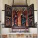 triumfbågens krön med Jesusmålningen kan skönjas.