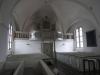 Interiör mot orgelläktaren i norra korsarmen.