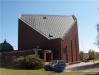 Katedralliknande byggnad i brunt tegel. Invigd 1973
