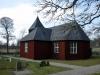 Fasader med rödmålad träpanel