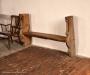 Skulpterade gavelstycken från 1500-talets korstol har använts till en brudbänk