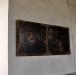 En tidigare altartavla hänger nu på södra väggen i långhuset