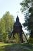 Klockstapeln som på uppländskt vis står en bit ifrån kyrkan