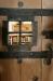 Man kan kika in till sakristian genom gallret i dörren.