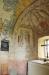 Notera den gallerförsedda luckan och runstenen med två kors. Altaret pryds av färska blommor...