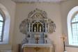 Dopfunt 1100-tal. Gravstenen på väggen minner om Jonas Nicolai Katt