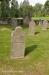 Ett flertal mycket gamla gravstenar finns kvar på kyrkogården