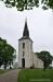 Humla kyrka 30 maj 2017 .En nött liljesten rest mot väggen bredvid tornet.