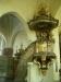 Den vackra predikstolen vars ljudtak kröns av en sjuarmad ljusstake.