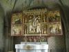 med runinskrift:Ödulv gjorde kyrkan