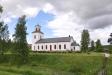 Transtrands kyrka sedd från ön med monumentet 17 juni 2012