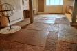 I stort sett hela kyrkans golv är täckt av gravhällar
