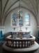 Altaret med korfönstren.