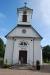 Vacker entréfasad och ett vackert torn i Öljehult kyrka.