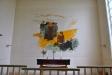 Altartavlan är målad direkt på väggen av Kalle Hedberg