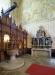 Gammal altare i folkbarock längst bak i kyrkan.