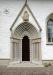 Runristad gravsten som flyttades in i kyrkan från kyrkogården. Notera de små svastikorna.