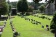 Kyrkogården med ett av gravkoren i söder.
