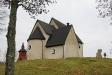 Kyrkan sitter stadigt på sin kulle