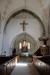 Predikstolen verkar vila på ett medeltida helgonaltare.