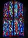 Glasmålningarna i korets södra vägg är målade av Erik Olsson