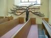 Norra korsarmen med ljusträdet och ett votivskepp